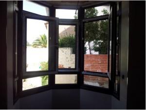 Puertas pvc k mmerling puertas a medida madrid for Puerta oscilobatiente